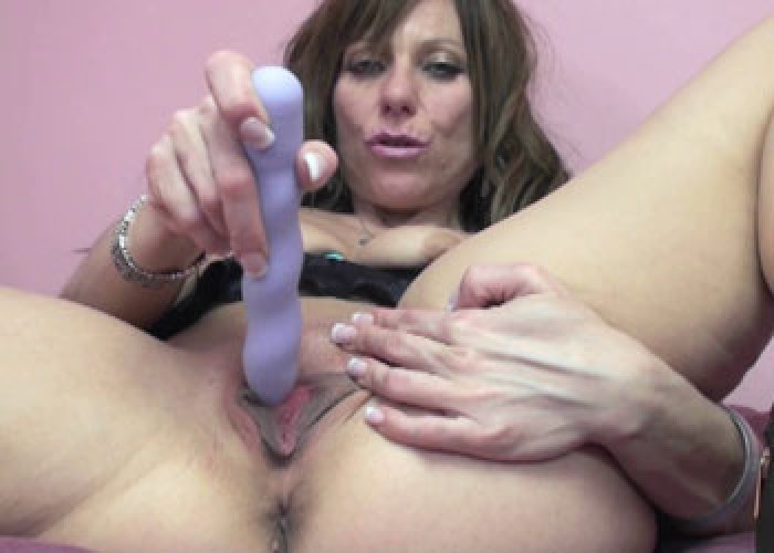 Mature brunette Brandi plays with her toy